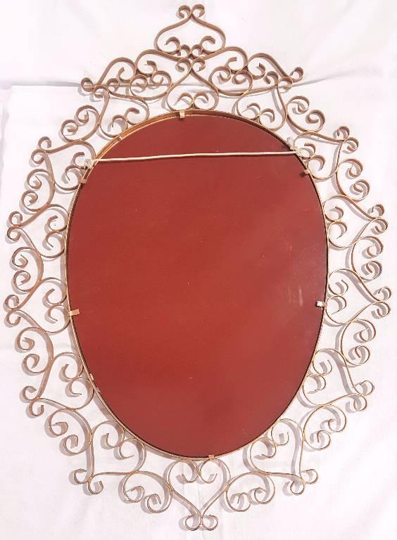 Miroir ovale en métal ocre   Puces Privées